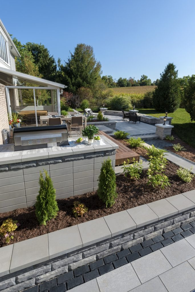 Dress Up a Retaining Wall with Built-In Planters in Waterloo, IL